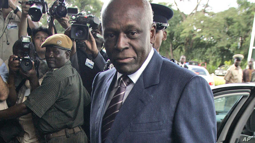 FILE - Angola's President Jose Eduardo dos Santos arrives at the Mulungushi International Conference Center in Lusaka, Zambia.