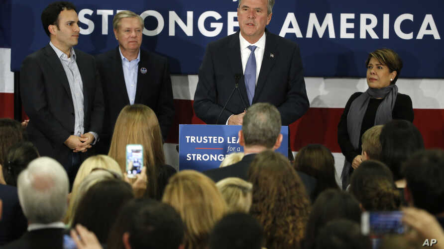 Republican presidential candidate, former Florida Gov. Jeb Bush accompanied by his wife, Columba, son Jeb Bush Jr., left, and Sen. Lindsey Graham, R-S.C., speaks in Columbia, S.C., Feb. 20, 2016.
