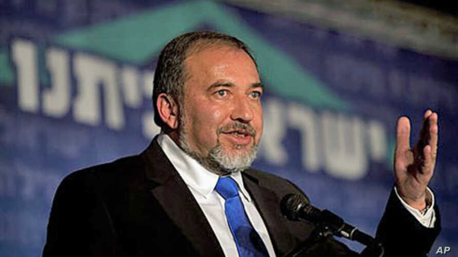 Israeli Foreign Minister Avigdor Lieberman speaks at a conference of his political party in Jerusalem, April 13, 2011