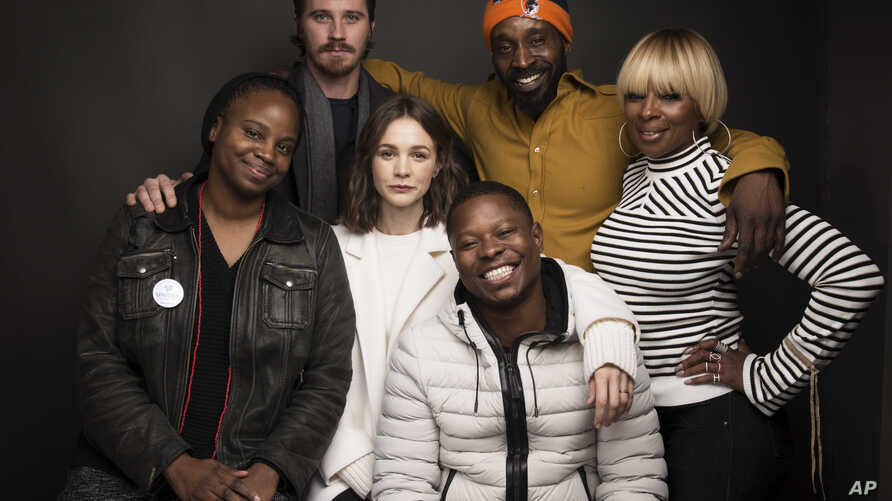 "Director Dee Rees, from left, actors Garrett Hedlund, Rob Morgan, Mary J. Blige, Carrey Mulligan, center, and Jason Mitchell, bottom, pose for a portrait to promote the film, ""Mudbound,"" at the Music Lodge during the Sundance Film Festival, Jan. 21,"