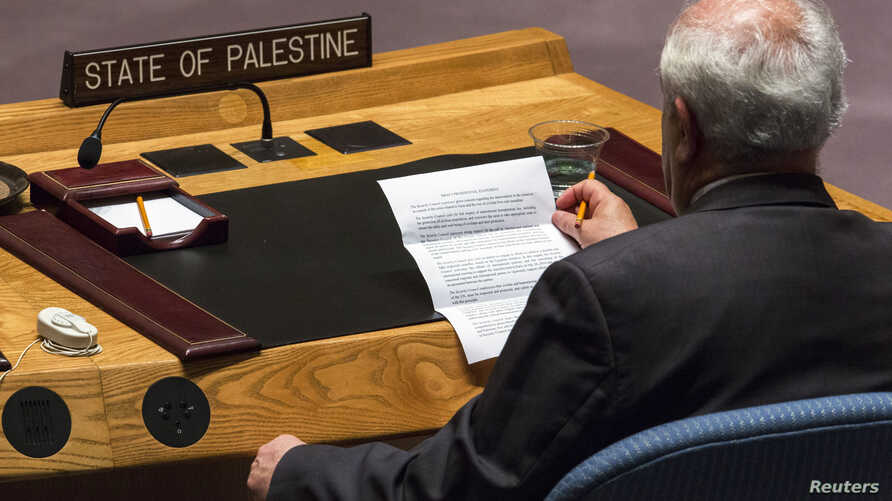 FILE - Palestinian U.N. Ambassador Riyad Mansour reads a statement from the President of the United Nations Security Council during a meeting at the U.N. headquarters in New York.