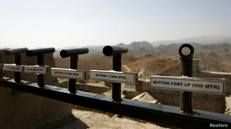 Location and range information is seen on a wall in the Kitton outpost along the border fence on the border with Afghanistan in North Waziristan, Pakistan Oct. 18, 2017.
