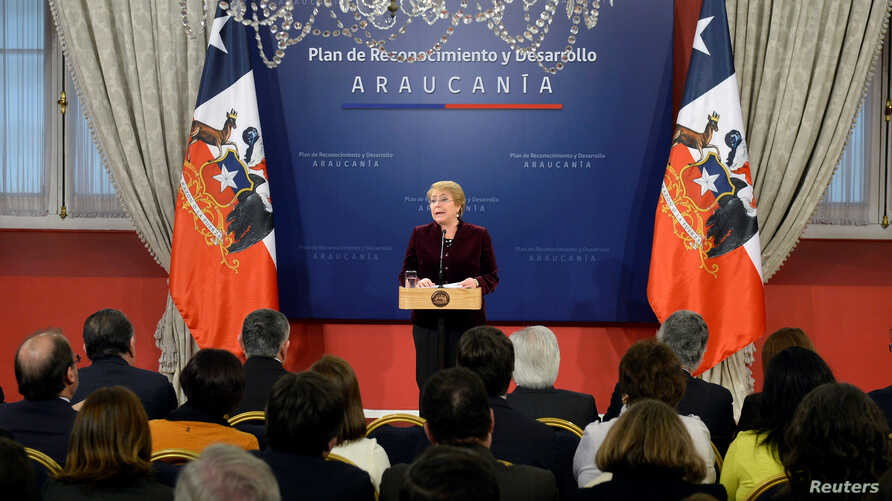 """Chile's President Michelle Bachelet delivers a message asking for forgiveness from indigenous Mapuche people for """"errors and horrors"""" committed by the state and announcing plans to give them more power and resources, at the government house in Santia"""