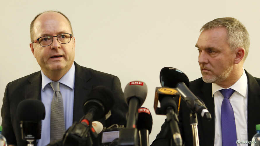 Geneva's Attorney General Olivier Jornot, left, and Francois Schmutz, head of Criminal Investigation Police, discuss the arrest of two people on terror charges, in Geneva, Switzerland, Dec. 12, 2015.