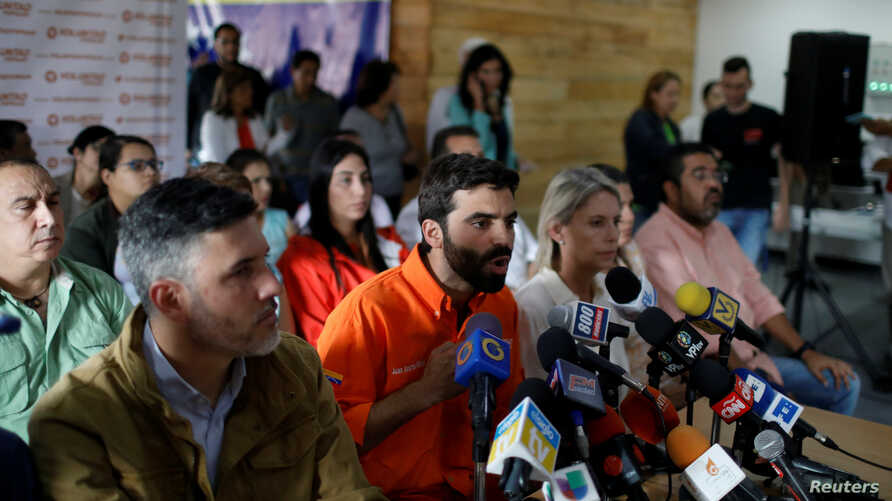 Juan Andres Mejia (C), lawmaker of the opposition party Popular Will (Voluntad Popular), talks to the media during a news conference in Caracas, Venezuela, Jan. 26, 2018.