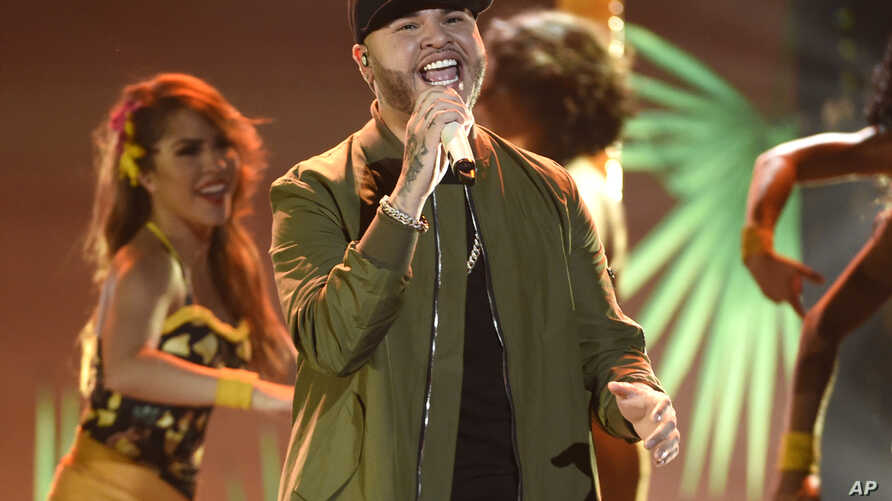FILE - Farruko performs at the Latin American Music Awards at the Dolby Theatre on Thursday, Oct. 8, 2015, in Los Angeles.