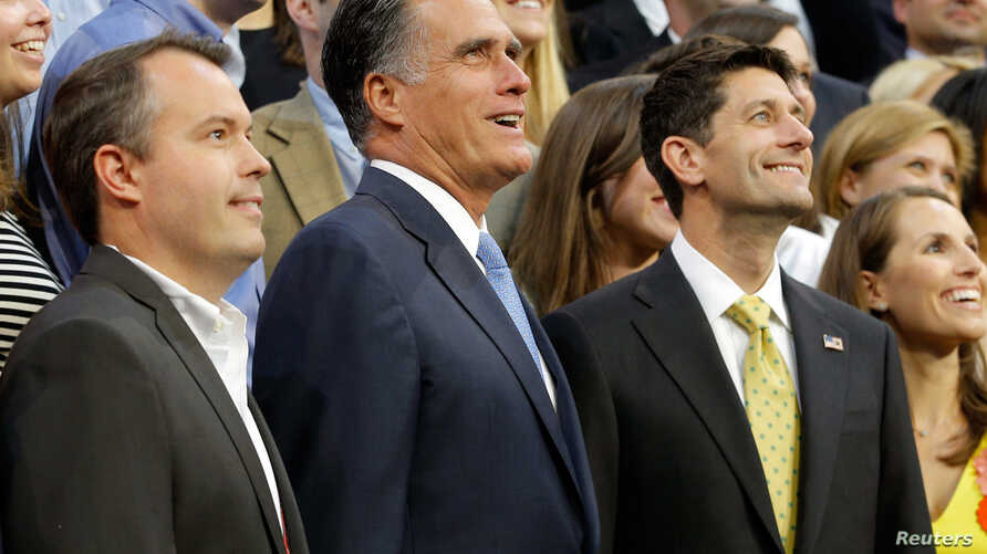 Mitt Romney, vice-presidential candidate Paul Ryan (R) and Campaign Manager Matt Rhoades pose for a staff portrait on the steps of the stage at the Republican National Convention, August 30, 2012.