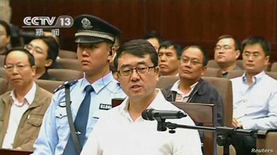 Former police chief Wang Lijun speaks during a court hearing in Chengdu in this still image taken from video September 18, 2012.