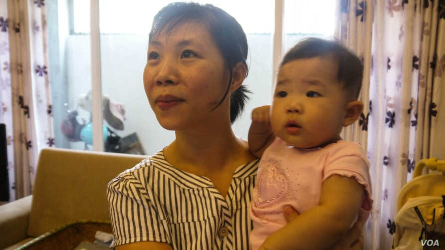 Tran Trinh is an educated and well-off woman, but she had hoped her daughter Minh would turn out to be a son. (VOA - L. Hoang)