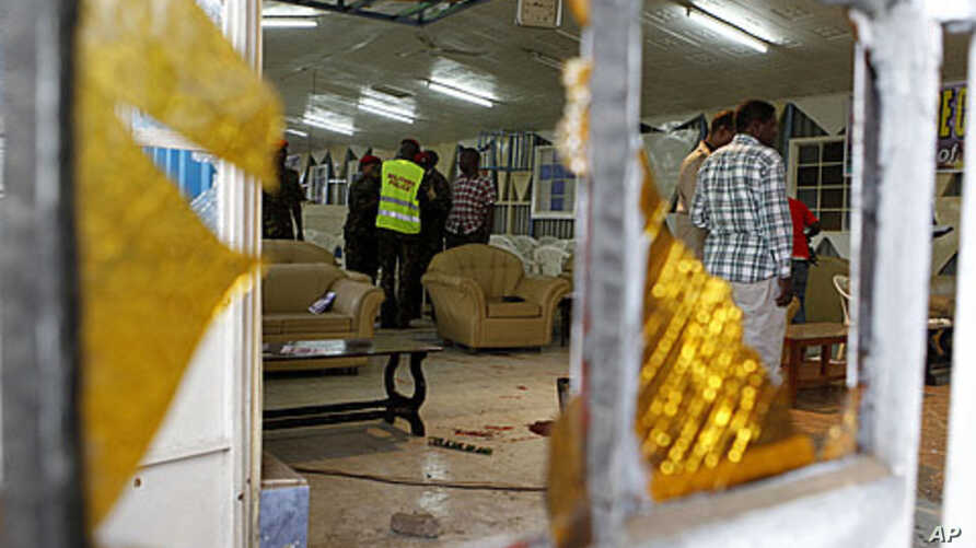 Detectives inspect the scene of an explosion inside the God's House of Miracles International Church in Nairobi, site of the April 29, 2012 grenade attack.