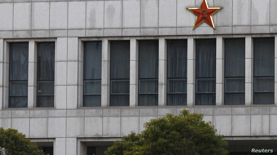 FILE - Part of the building of 'Unit 61398,' a secretive Chinese military department, is seen on the outskirts of Shanghai.