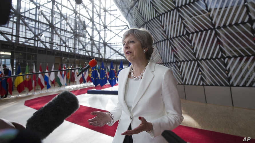 British Prime Minister Theresa May speaks with the media as she arrives for an EU summit at the Europa building in Brussels, June 23, 2017. European Union leaders meet in Brussels on the final day of their two-day summit to focus on ways to stop migr
