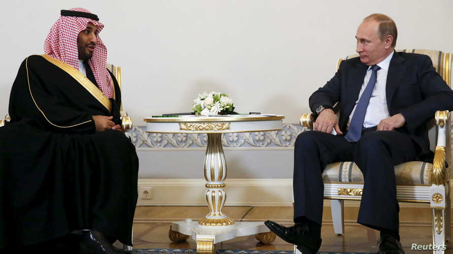 Russian President Vladimir Putin (R) attends a meeting with Saudi Defence Minister Prince Mohammad Bin Salman at the Konstantin (Konstantinovsky) Palace in St. Petersburg, Russia, June 18, 2015. REUTERS/Grigory Dukor