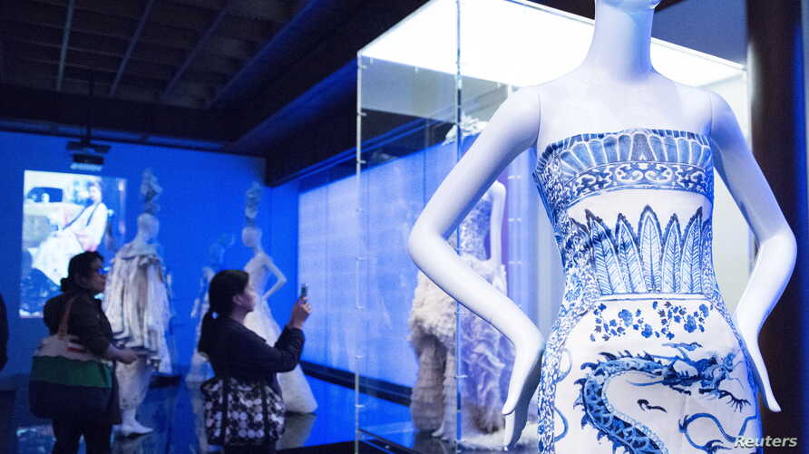 """Members of the media view selections for the Metropolitan Museum of Art Costume Institute Gala Benefit, """"China: Through the Looking Glass,"""" during a media preview at the Metropolitan Museum of Art in New York, May 4 , 2015."""