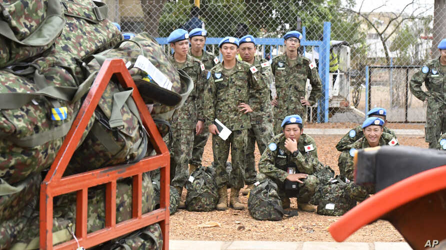 FILE - Japan's Ground Self-Defense Force troop members wait to board a plane as they start leaving South Sudan as part of the process to end their five-year participation in the ongoing U.N. peacekeeping mission in the country, April 17, 2017.