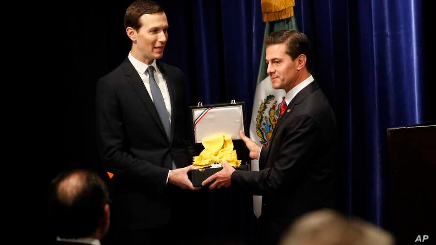 Mexican President Enrique Pena Neto (R) awards White House Senior Adviser Jared Kushner with The Order of the Aztec Eagle, the highest Mexican order awarded to foreigners, Nov. 30, 2018, in Buenos Aires, Argentina.