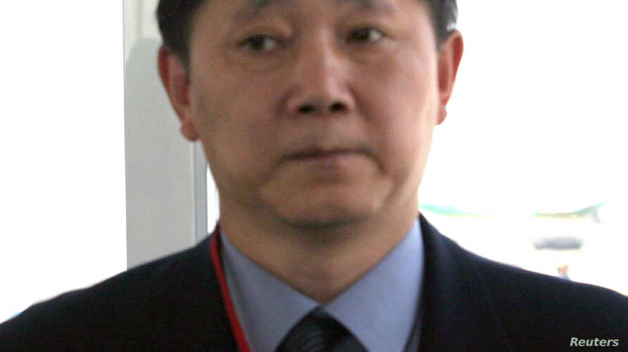 FILE - Sun Yuxi at the time Chinese Ambassador to Afghanistan sits on a bus at Kabul airport, June 10, 2004. Sun was on his way to Kunduz, where gunmen had killed 11 Chinese road workers.