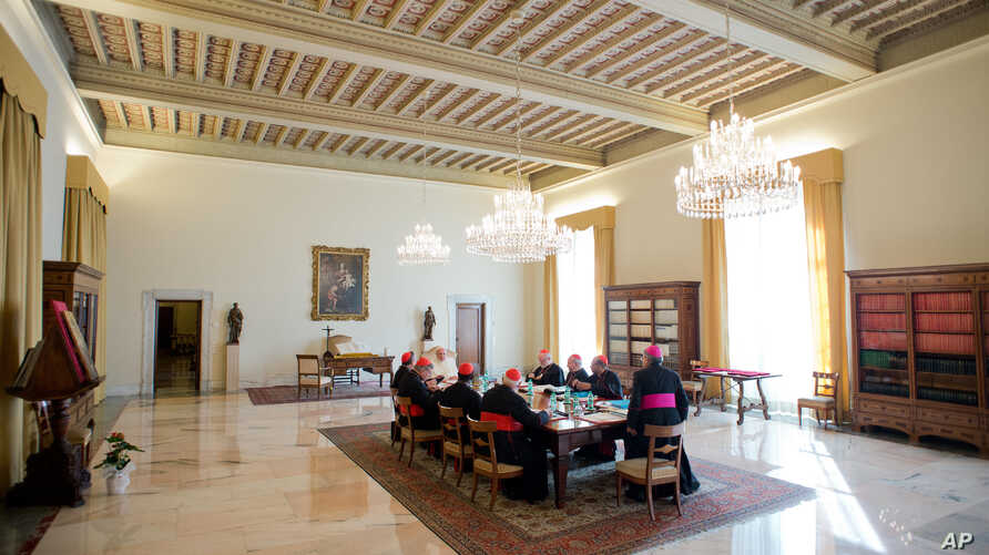 """In this picture provided  Oct. 1, 2013 by the Vatican newspaper L'Osservatore Romano, Pope Francis sits with his so-called """"Group of Eight"""" cardinals, during their first meeting at the Vatican."""