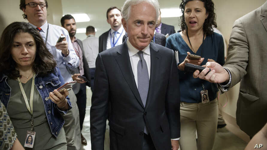 Senate Foreign Relations Committee Chairman Bob Corker, R-Tenn., talks to reporters as he returns to his office from a vote, on Capitol Hill in Washington, Oct. 25, 2017.