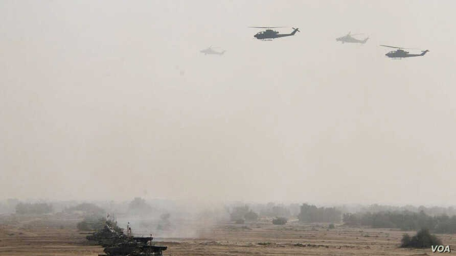 Pakistan's army tanks and helicopters, seen in this army-issued photo, take part in a military exercise in Khairpur Tamiwali, Pakistan, Wednesday, Nov. 16, 2016.