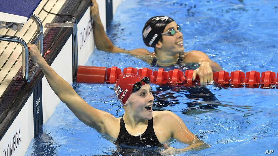 Britain's Siobhan-Marie O'Connor, left, and United States' Maya DiRado smile as they check their times after a women's 200-meter individual medley heat during the swimming competitions at the 2016 Summer Olympics, Monday, Aug. 8, 2016.