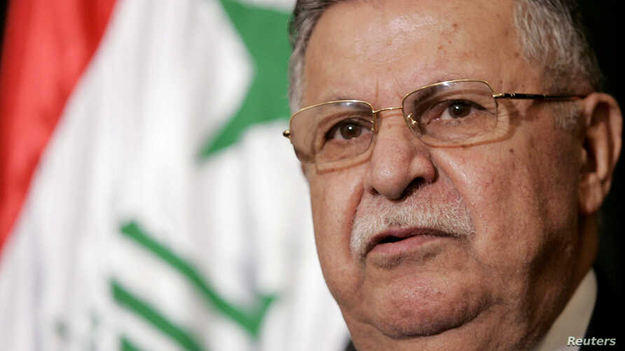 FILE - Iraqi President Jalal Talabani speaks at a news conference following his meeting with Director of U.S. Foreign Assistance and USAID Administrator Ambassador Randall L. Tobias in the heavily fortified Green Zone in Baghdad, May 25, 2006.