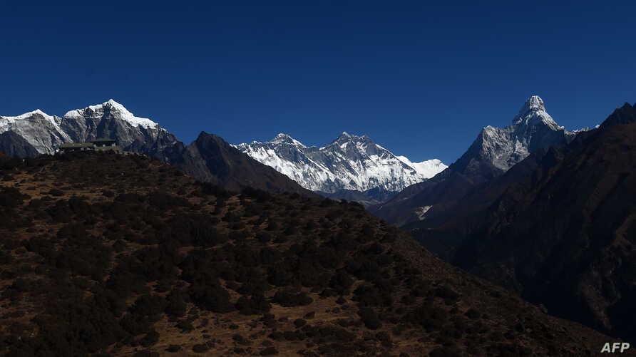 This photograph taken from a helicopter shows an aerial view of Mount Everest in Nepal's Solukhumbu district, some 140 kilometers   (87 miles) northeast of Kathmandu, on Nov. 22, 2018.