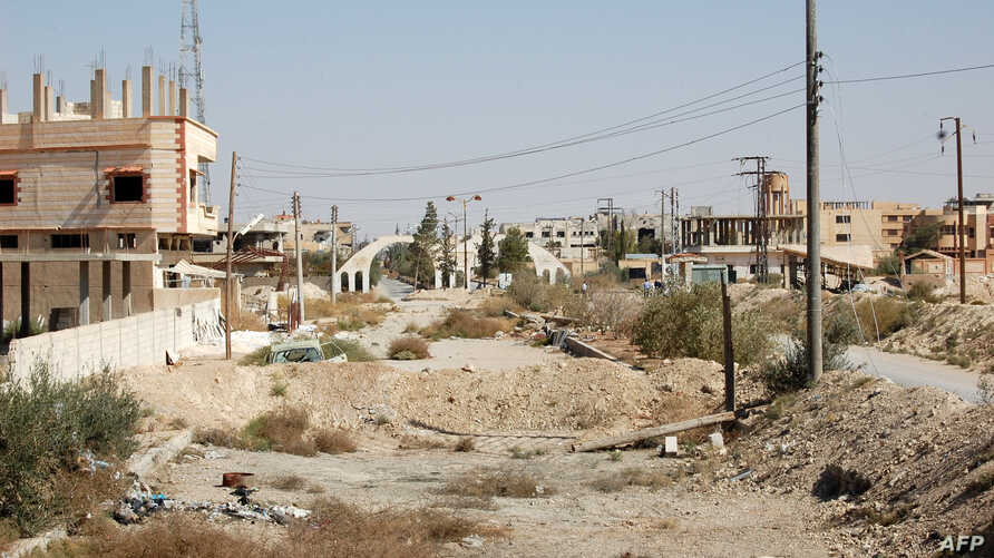 A general view shows a heavily damaged road in the recently retaken desert town of Al-Qaryatain on Oct. 22, 2017.