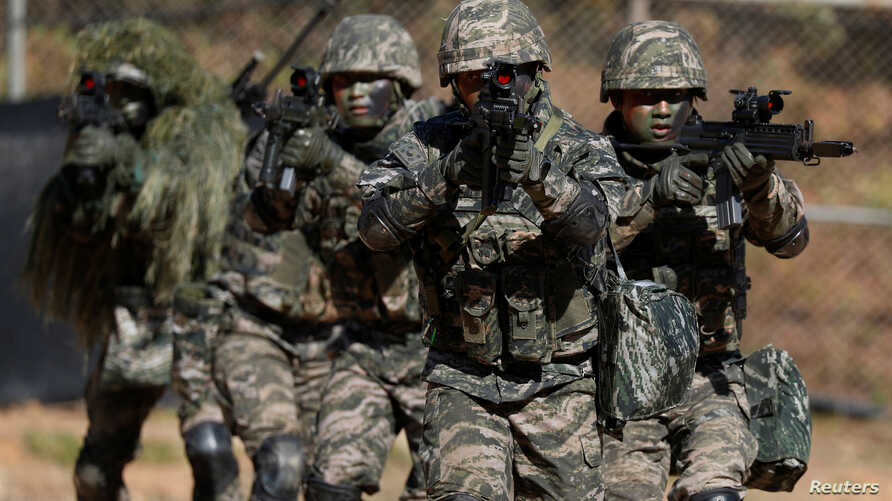 FILE - South Korean marines are pictured in action during a regular drill on Yeonpyeong Island, Nov. 1, 2018.
