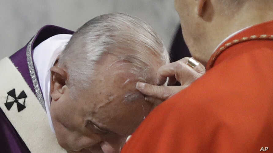 Cardinal Jozef Tomko puts ashes on Pope Francis' forehead, at the Basilica of Saint Sabina in Rome, Feb. 14, 2018.