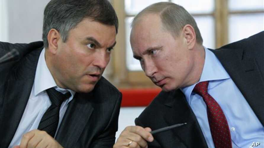 FILE - Then-Russian Prime Minister Vladimir Putin, right, speaks with his then-Chief of Staff Vyacheslav Volodin during a meeting of officials in Pskov in May 2011. Volodin is on a list of Russian officials facing US sanctions. (AP Photo/RIA Novosti,