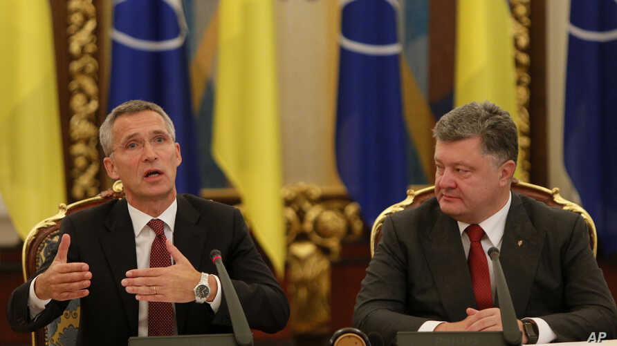 Ukrainian President Petro Poroshenko (R) looks at NATO Secretary General Jens Stoltenberg as he speaks during a meeting of the National Security and Defense Council of Ukraine in Kyiv, Ukraine, Sept. 22, 2015.