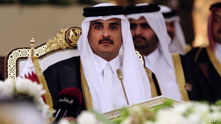 FILE- In this Dec. 9, 2014, file photo, Qatar's Emir Sheikh Tamim bin Hamad Al-Thani attends a Gulf Cooperation Council summit in Doha, Qatar.