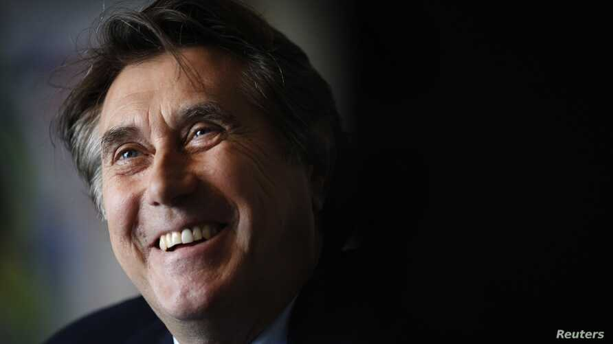 """English singer Bryan Ferry smiles during an interview promoting his new new album """"Olympia"""" in Berlin, October 12, 2010."""