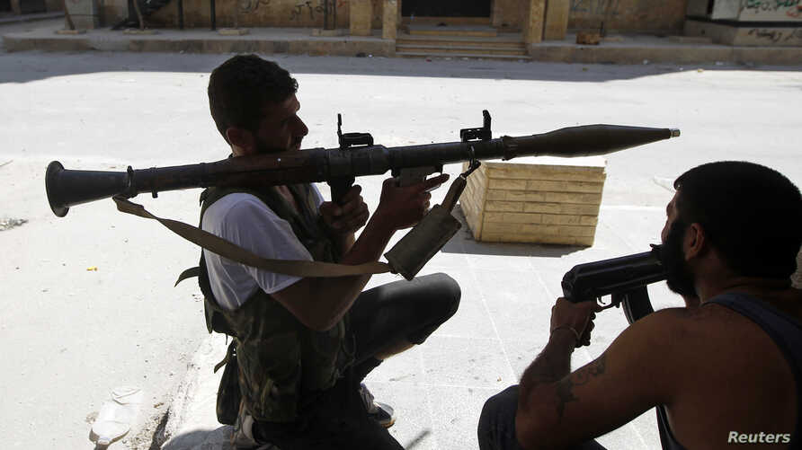 A Free Syrian Army fighter aims a RPG as he waits for Syrian Army tanks in the Salaheddine neighbouhood of central Aleppo, August 10, 2012.