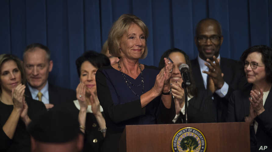 Education Secretary Betsy DeVos is applauded after addressing the staff at the Department of Education, Feb. 8, 2017, in Washington.