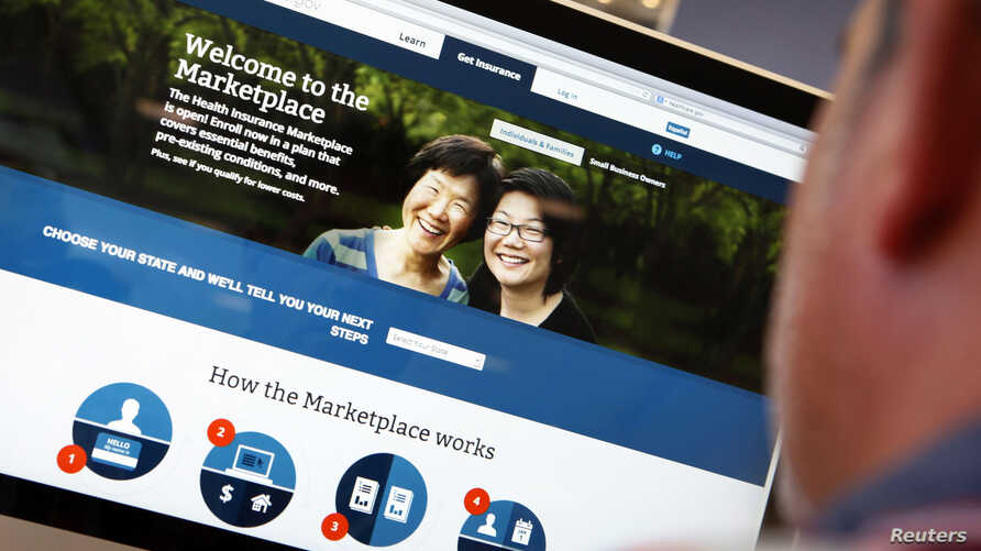 FILE - A man looks over the Affordable Care Act (commonly known as Obamacare) signup page on the HealthCare.gov website in New York in this photo illustration.