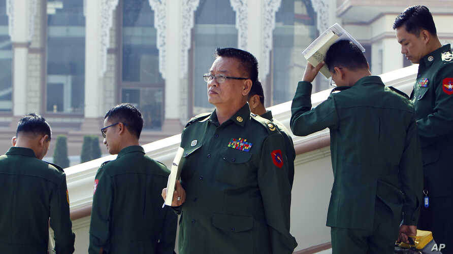 Military representatives leave after attending a regular session of the Union Parliament in Naypyitaw, Myanmar, Jan. 29, 2019.