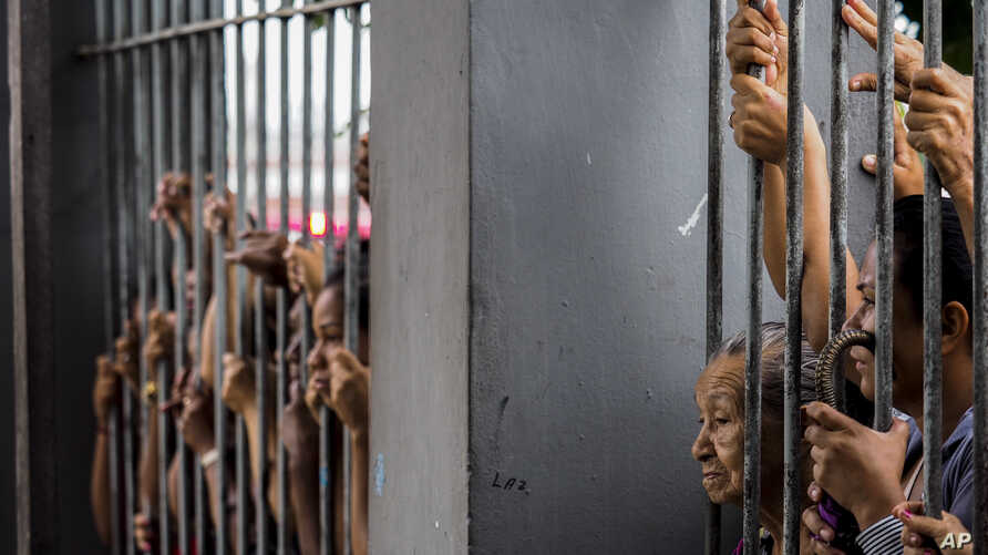 Relatives wait for information following a riot that ended with at least four prisoners killed inside Desembargador Raimundo Vidal Pessoa Public Jail, Jan. 8, 2017, in Manaus, Amazonas, Brazil.