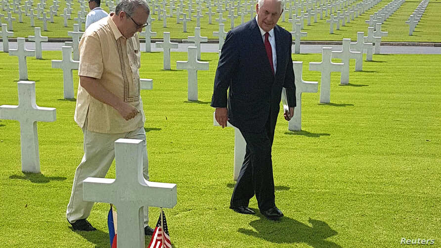 Rex Tillerson, right, U.S. Secretary of State, walks with Bobby Bell, the deputy administrator of the American Battlefield Memorial commission, during Tillerson's visit at the American cemetery in Taguig city, metro Manila, Philippines Aug. 6, 2017.