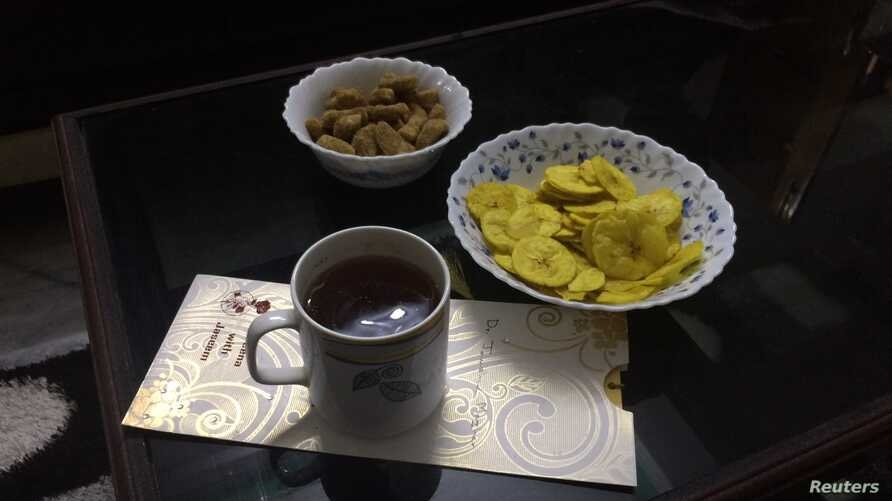Tea and snacks are seen at the home of a resident of Kavaratti island, the capital of India's Lakshadweep islands, May 6, 2018.