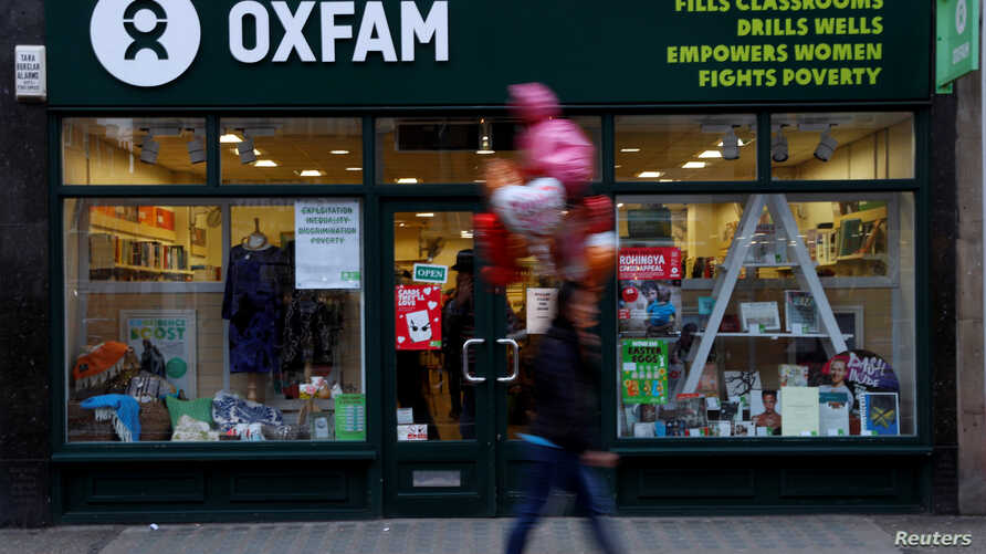 A pedestrian walks past a branch of Oxfam, in London, Feb. 12, 2018.