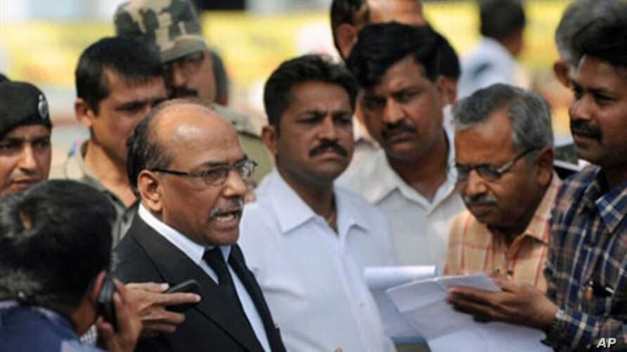 Public Prosecutor Rajendra Tiwari (L) addresses media representatives following the verdict on the 2002 Godhra train incident at the special court inside the Sabarmati Central Jail in Ahmedabad