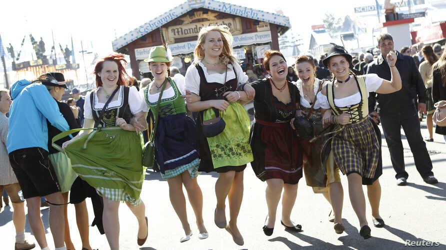 Young women in traditional Bavarian dirndls pose at Munich's Oktoberfest October 3, 2013.