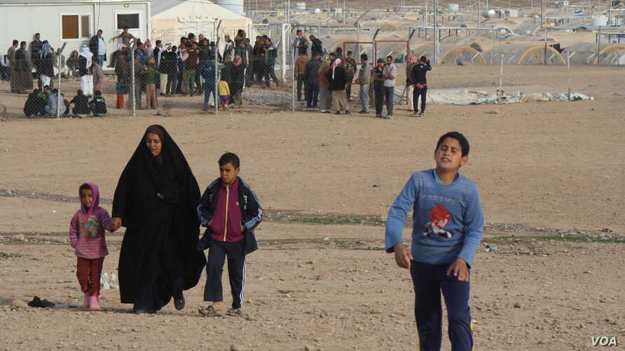Camp officials say IS families continue to arrive at the Haj Ali camp daily fearing retribution attacks, keeping the camp filled despite the fact that many families that fled IS are going home, Dec. 27, 2017.