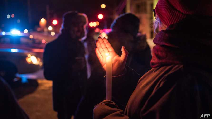 People come to show their support after a shooting occurred in a mosque at the Québec City Islamic cultural center on Sainte-Foy Street in Quebec city on Jan. 29, 2017.