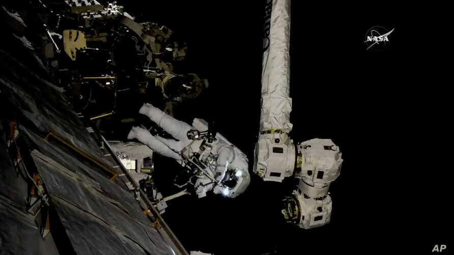 In this frame from NASA TV, Astronaut Mark Vande Hei works on the International Space Station, Oct. 5, 2017.