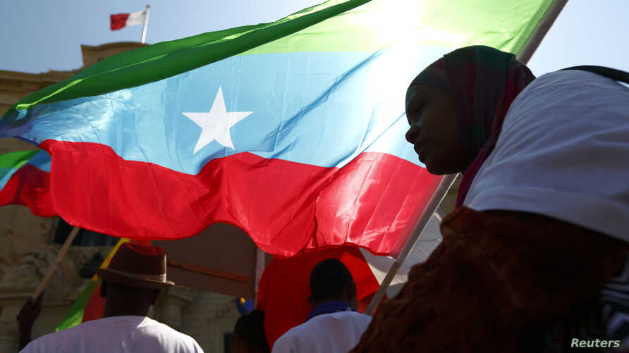 FILE - Members of the Oromo community of Ethiopia, living in Malta, protest against the Ethiopian regime and its plan to displace Oromo farmers outside the office of Malta's Prime Minister in Valletta June 16, 2014. Recent protests in Ethiopia have l...