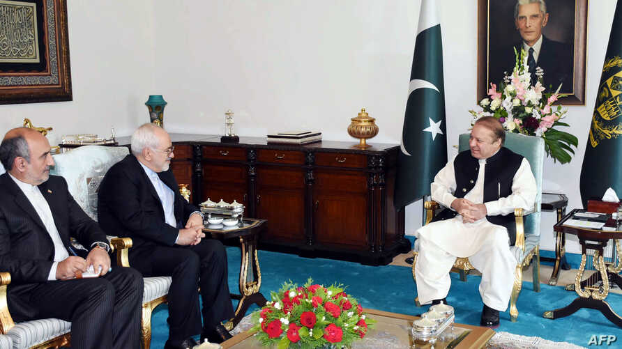 In this handout photograph released by the Press Information Department (PID) on May 3, 2017, Pakistan's Prime Minister Nawaz Sharif (R) meets with Iranian Minister of Foreign affairs Mohammad Javad Zarif (2L) at the Prime Minister's House in Islamab