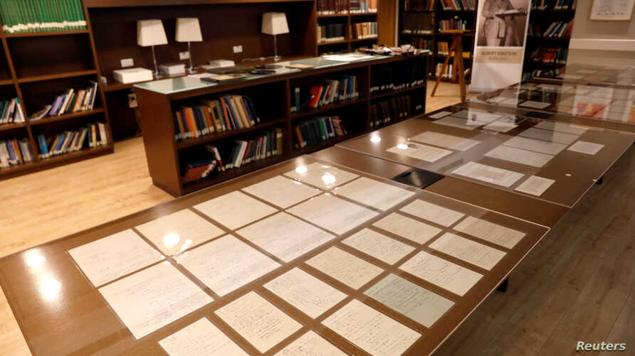 Part of a collection of 110 manuscript pages written by Albert Einstein that were unveiled by Israel's Hebrew University are seen on display at the university in Jerusalem, March 6, 2019..
